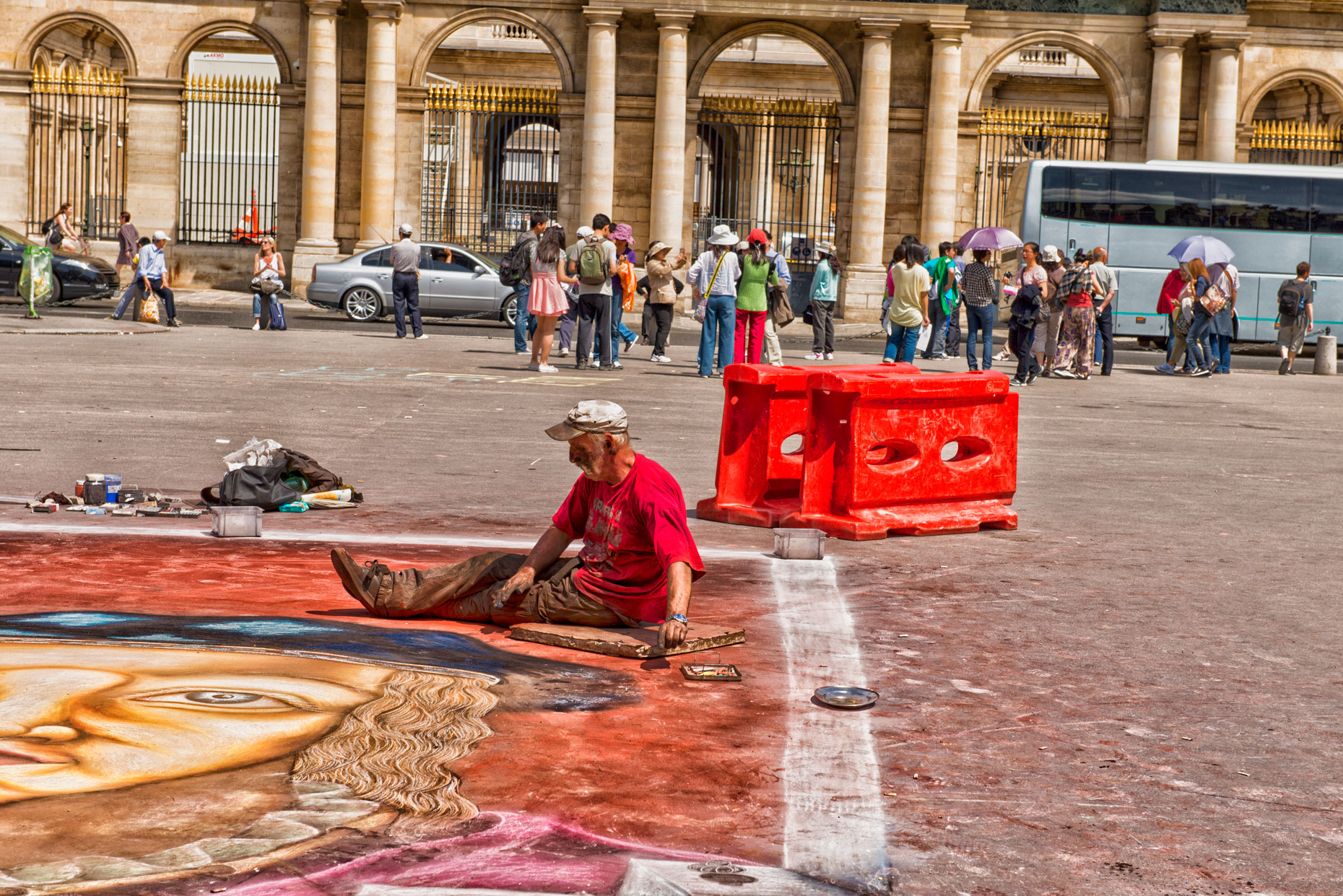 Chalk artist outside Louvre in Paris